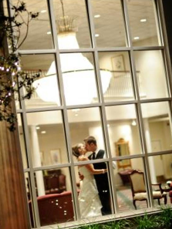 Presidential Catering wedding image of husband and wife kissing.