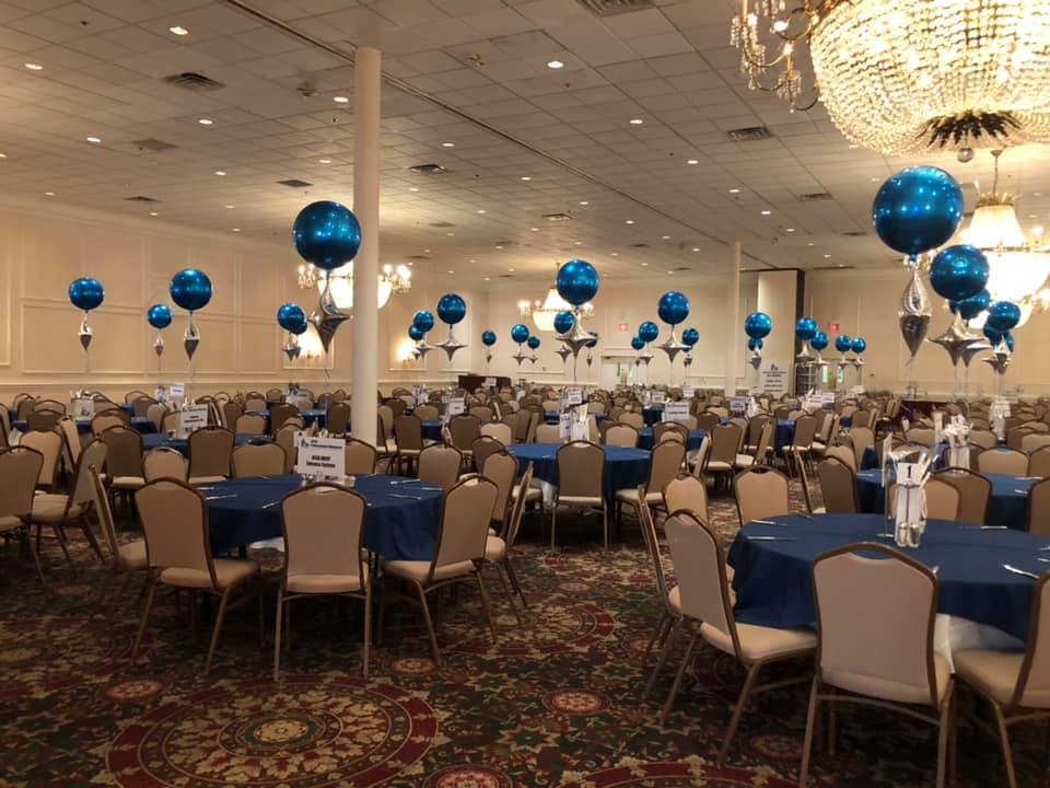 Corporate event from Presidential Catering with blue linens and balloons.