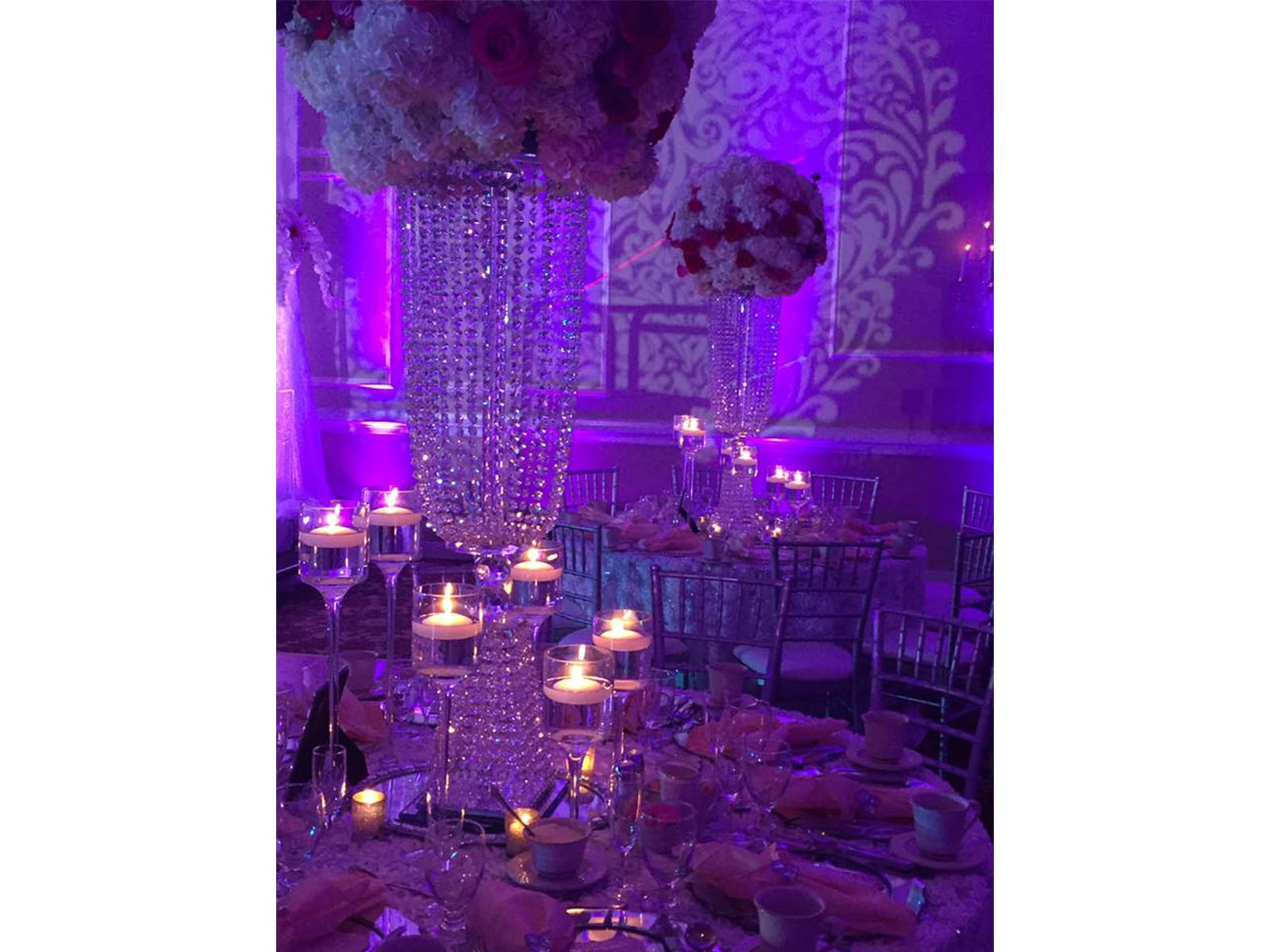 Wedding reception with purple uplighting from Presidential Catering.