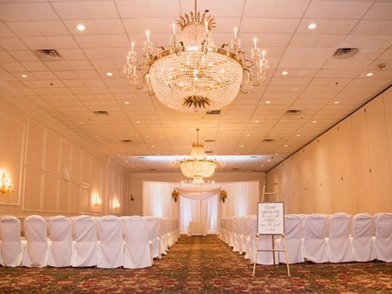 Indoor wedding ceremony from Presidential Catering